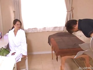 Asian MILF oiled up before a massage plus a blowjob
