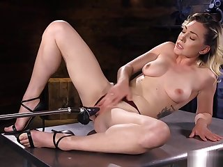 Blonde Milf fucks machines