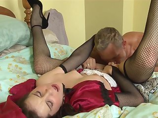 Adult on every side low-spirited fishnets enjoys good cock on every side her tiny holes
