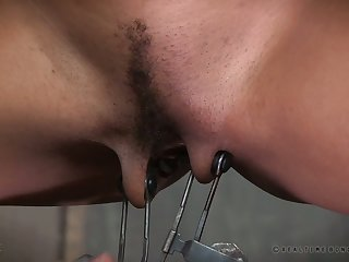 Horny submissive chick gets vicious weighted clamps on her pussy lips