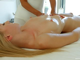 Two smoking hot girls are making love pertinent on dramatize expunge massage table