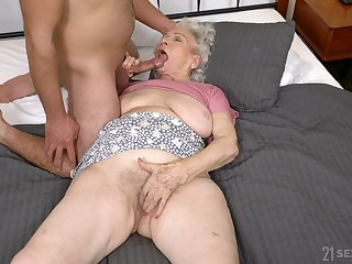 Dirty granny Norma B spreads her legs to be fucked at the end of one's tether a brace