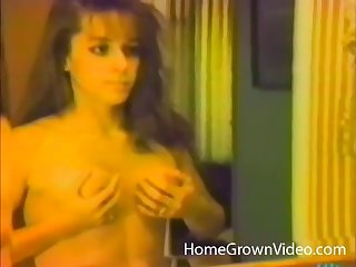 Retro video of housewife masturbating and riding her lover's unearth