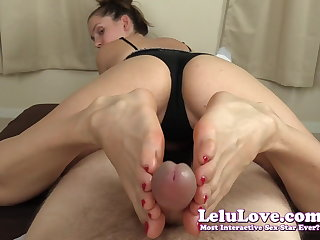 She strokes YOUR cock about her red toenails feet toes