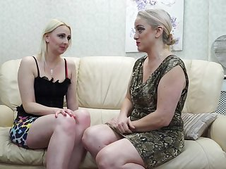 Two of age lesbians are making honour on the couch and moaning from pleasure while cumming