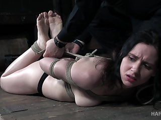 Tied helter-skelter Audrey Holiday gets her pussy toyed with regard to the dark BDSM courtyard
