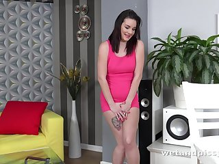 Amanda busting for a pee so she pees on the floor before masturbating