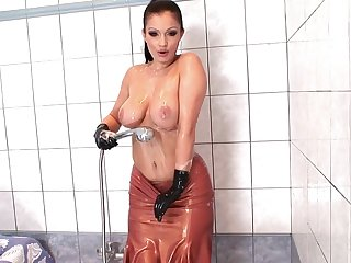 Alone model Aria Giovanni in latex enjoys pleasuring her pussy